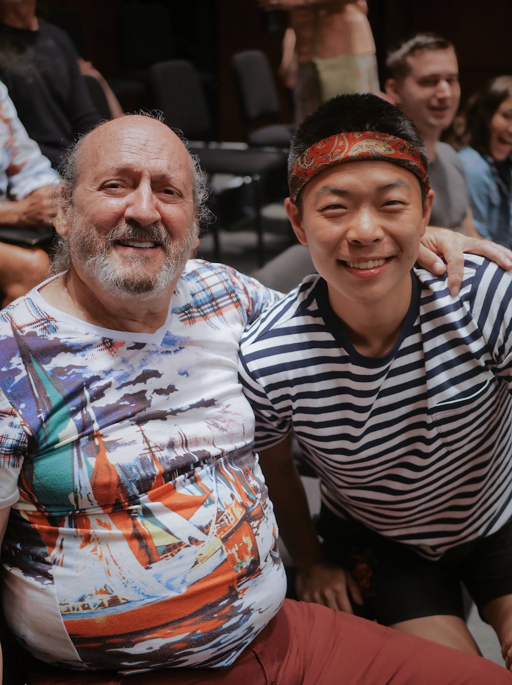 Jae Noh poses with a member of the MCO Chorus during a rehearsal at the Maui Arts & Cultural Center