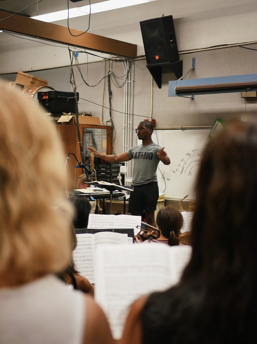 Tyrone Clinton conducts the MCO and Chorus during a rehearsal with the Chamber Singers