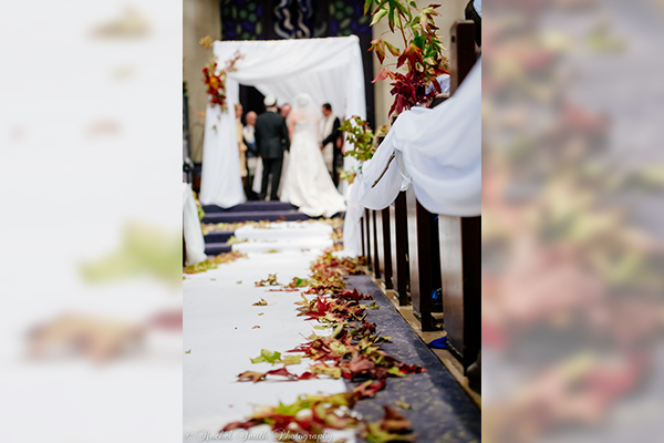 Fall Wedding | Aisle | hiking autumn theme decor by Innovative Party Planners at Chizuk Amuno