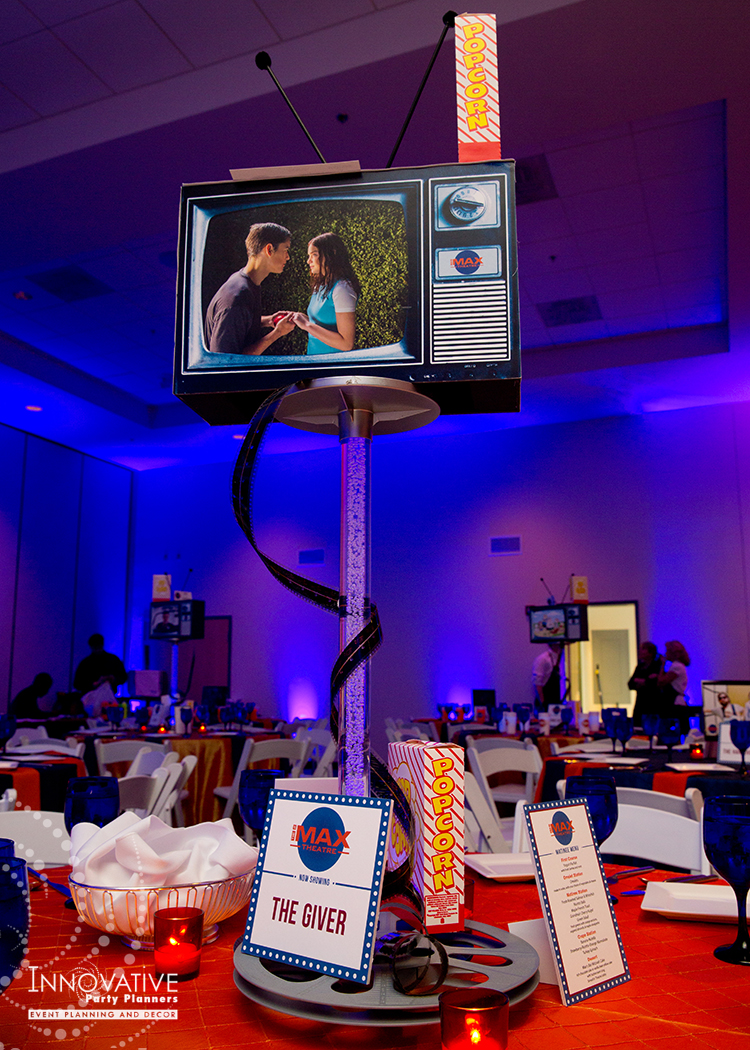 To The Max | Adult Centerpieces | Bar Mitzvah TV theme and movie theme decor by Innovative Party Planners at Temple Beth Ami