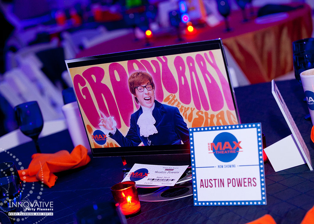 To The Max | Centerpieces | Bar Mitzvah TV theme and movie theme decor by Innovative Party Planners at Temple Beth Ami