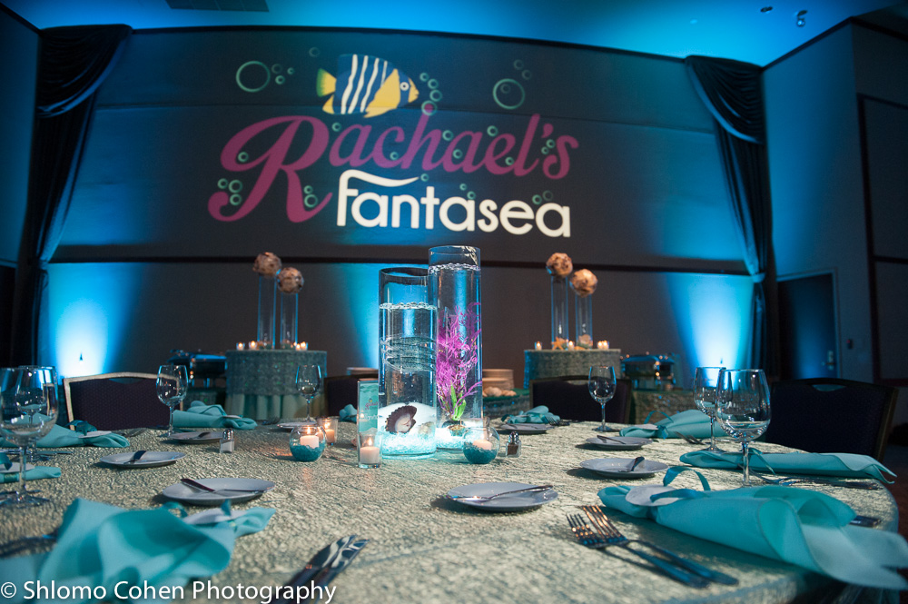 Rachaels Fantasea   Wall Projection and Adult Table  Bat Mitzvah under the sea theme decor by Innovative Party Planners at Oheb Shalom
