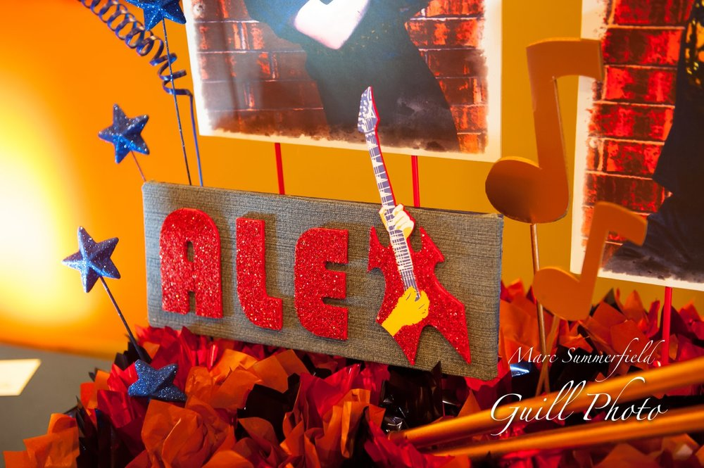 Alex Live in Concert   Placecard Table Centerpiece   Bar Mitzvah concert theme, music theme, singing theme, guitar theme, keyboard theme, decor by Innovative Party Planners at Oheb Shalom