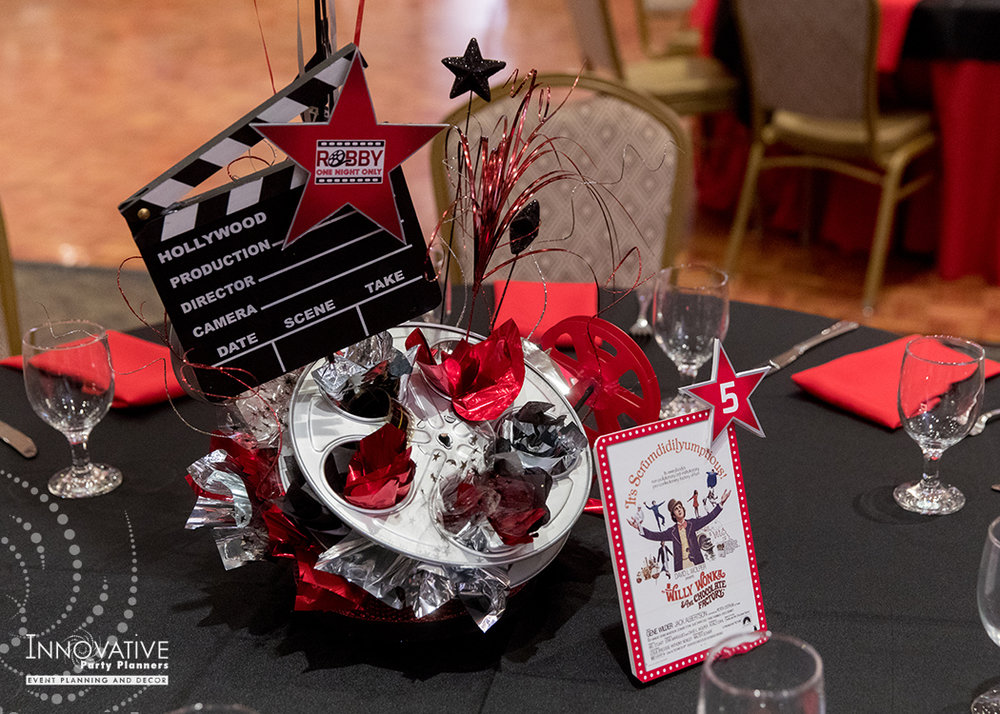 Robby One Night Only | Adult Table Centerpieces | Bar Mitzvah movie theme decor by Innovative Party Planners at Ten Oaks Ballroom