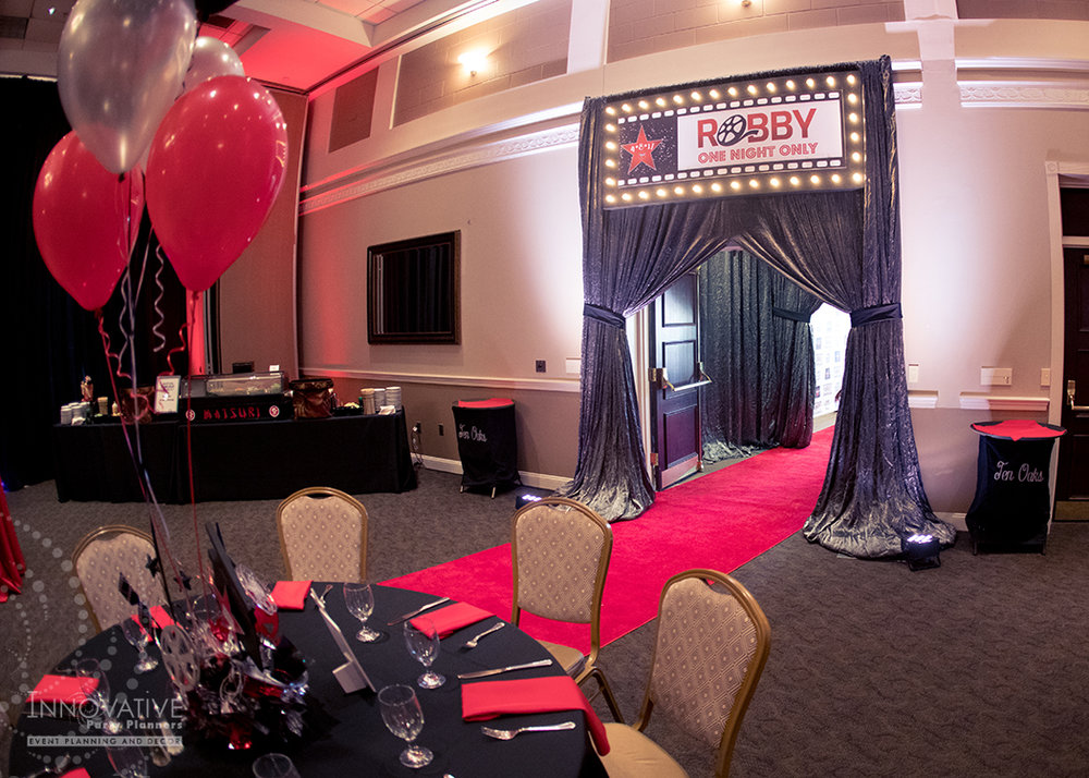 Robby One Night Only | Entrance | Bar Mitzvah movie theme decor by Innovative Party Planners at Ten Oaks Ballroom