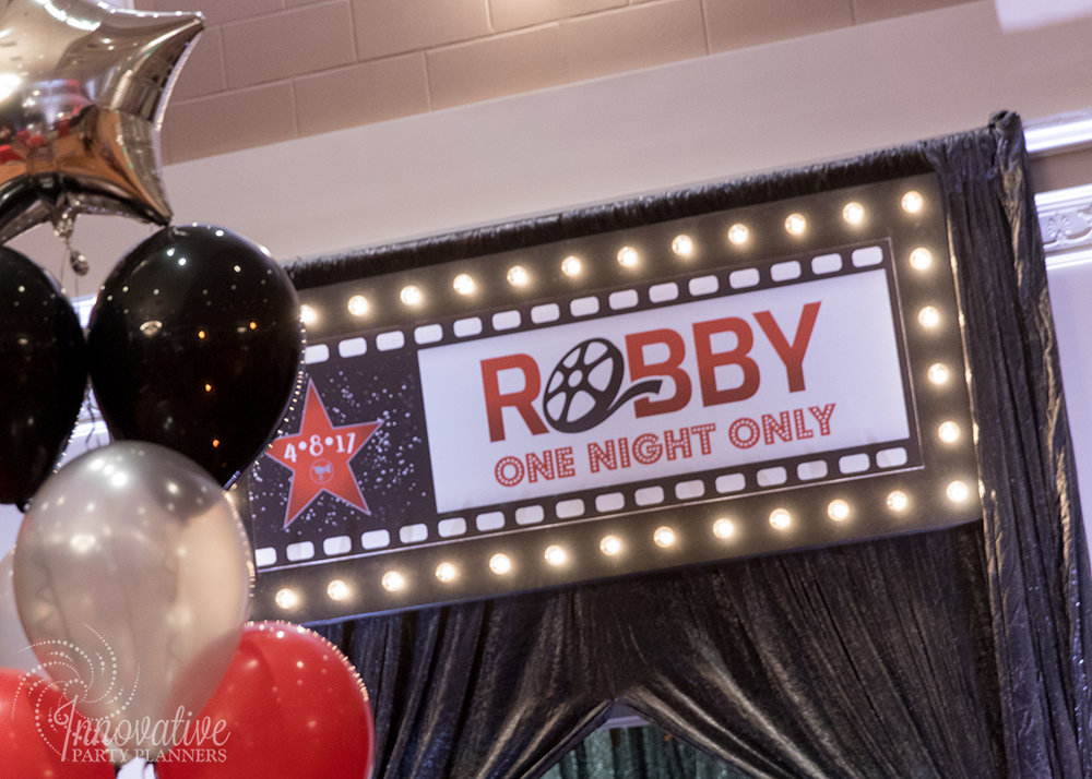 Robby One Night Only | Entrance Sign | Bar Mitzvah movie theme decor by Innovative Party Planners at Ten Oaks Ballroom