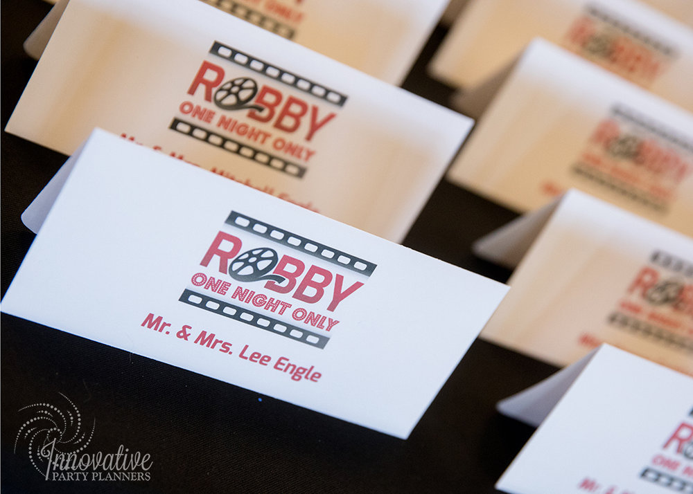 Robby One Night Only | Place Cards | Bar Mitzvah movie theme decor by Innovative Party Planners at Ten Oaks Ballroom