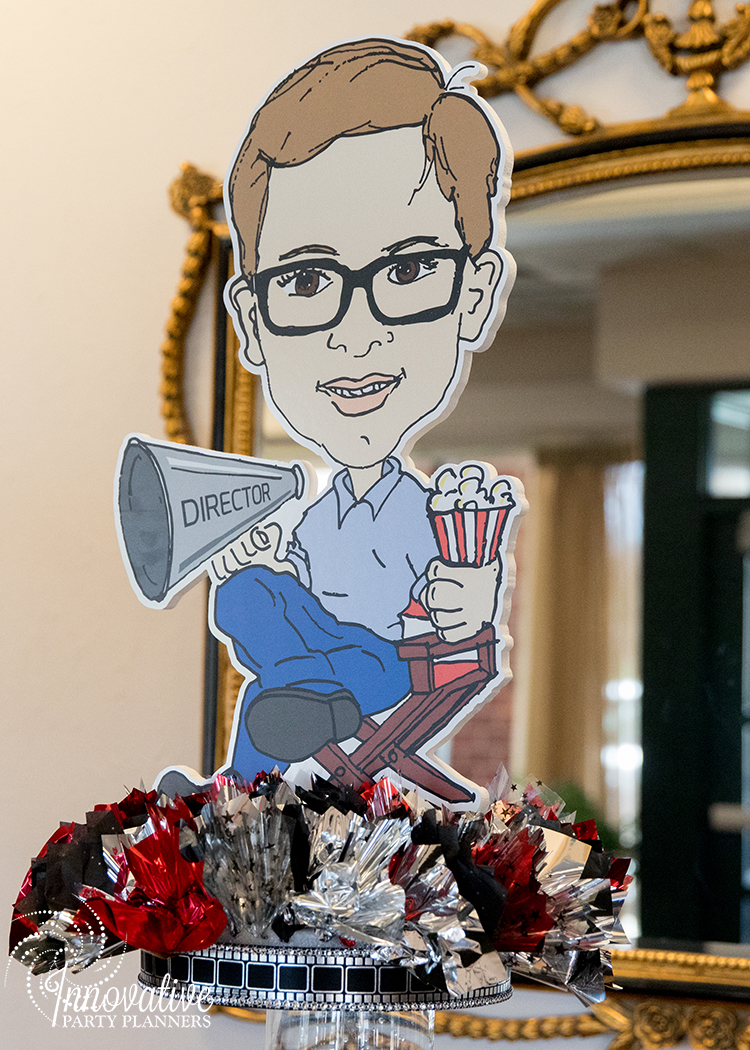 Robby One Night Only | Place Card Table Caricature Centerpiece | Bar Mitzvah movie theme decor by Innovative Party Planners at Ten Oaks Ballroom
