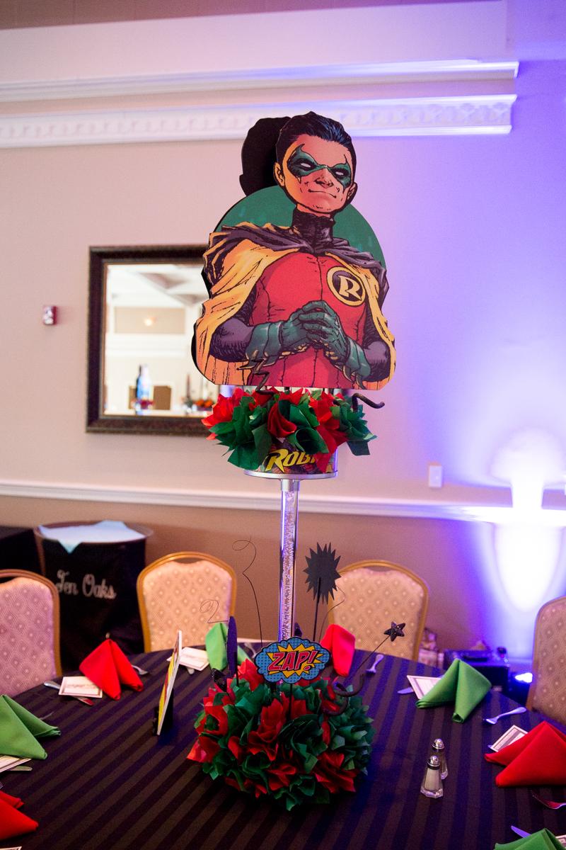 Elis Superheros | Robin Centerpiece| Bar Mitzvah superhero theme, comic book theme, Superman, Batman, X-men, Marvel,decor by Innovative Party Planners at Ten Oaks