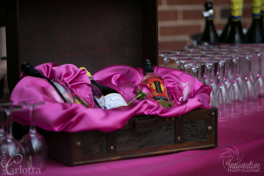 Anniversary Party | Wine Basket | Travel theme decor by Innovative Party Planners at the Gramercy Mansion Carriage House
