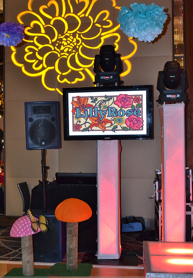 Lilly Rose | DJ Booth | Bat Mitzvah pink and orange monet garden theme decor by Innovative Party Planners at Four Seasons