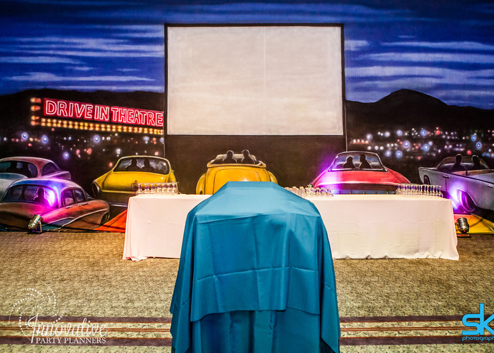 Leannes Drive In Movies and Decades | Drive-in Projector Backdrop | Bat Mitzvah movie theme decor by Innovative Party Planners at Oheb Shalom
