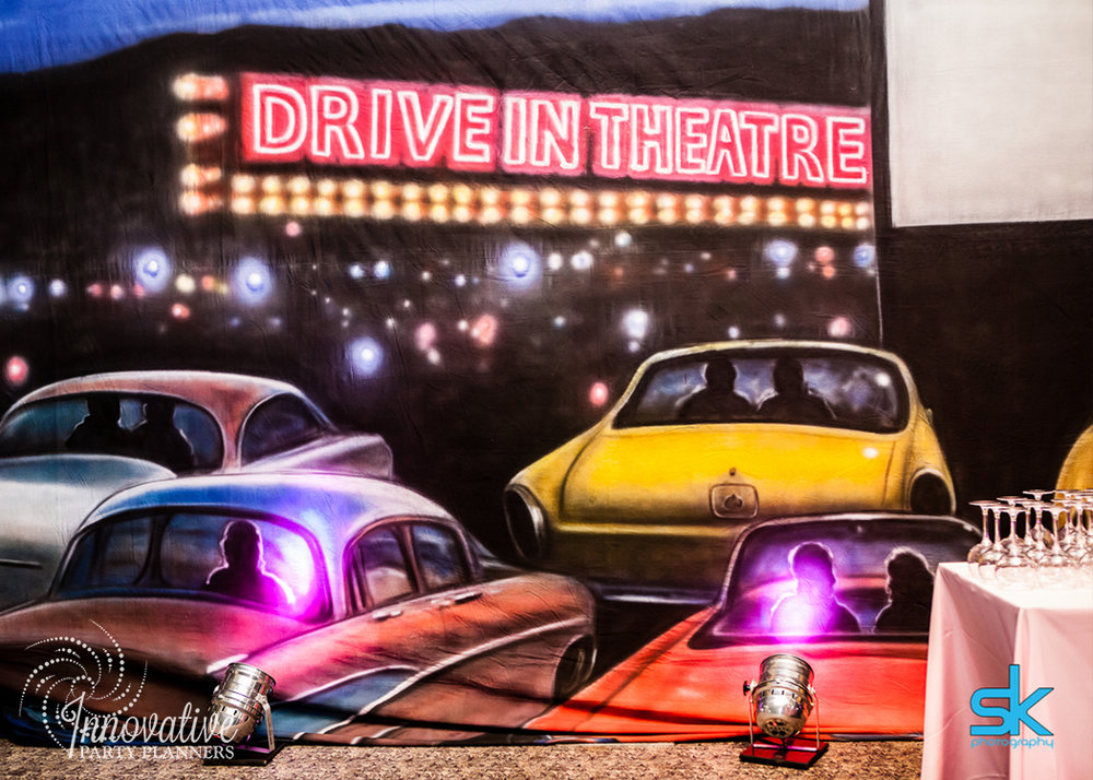 Leannes Drive In Movies and Decades | Drive-inBackdrop | Bat Mitzvah movie theme decor by Innovative Party Planners at Oheb Shalom