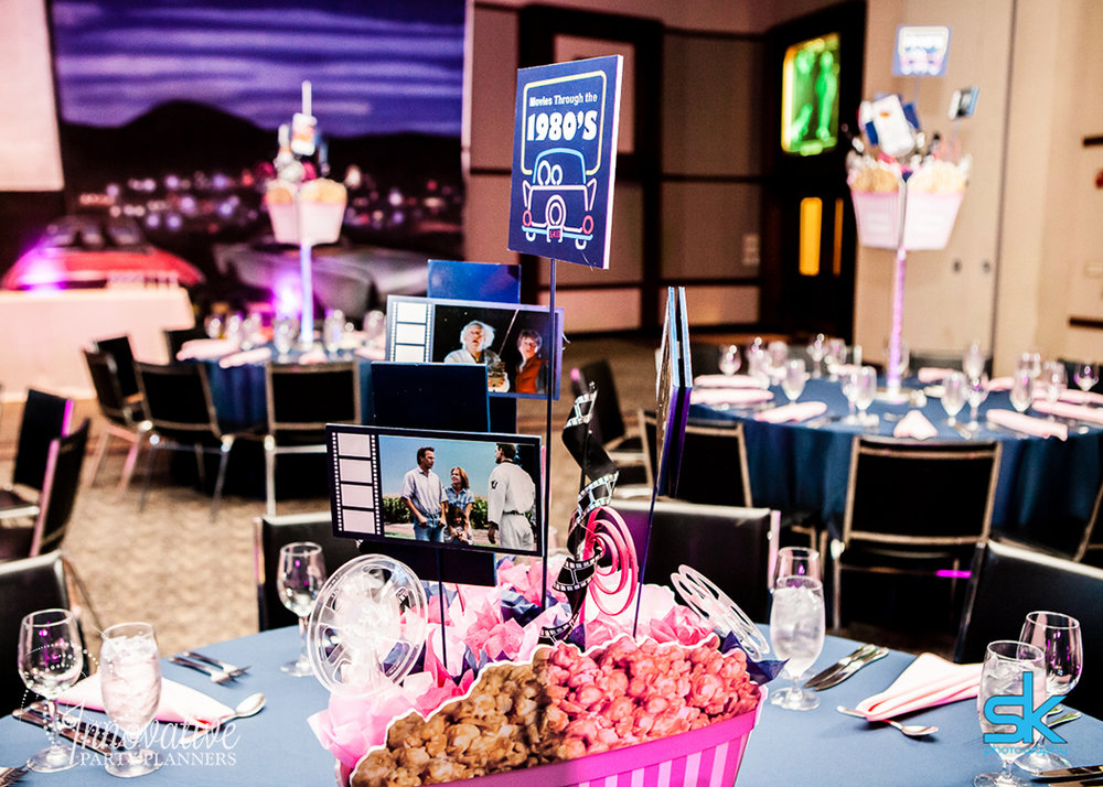 Leannes Drive In Movies and Decades | Adult Centerpieces | Bat Mitzvah movie theme decor by Innovative Party Planners at Oheb Shalom