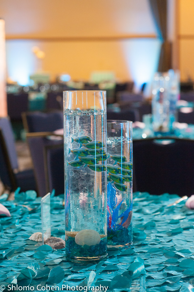 Teen centerpieces each featured a favorite under water mamal or fish of Rachael's with Atlantis ruins