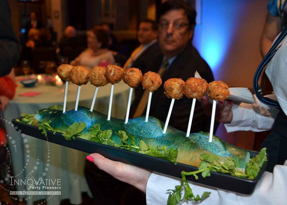 Clever presentation of passed hors d'oeuvres by Linwoods Catering