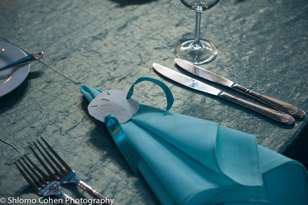Aqua blue napkins were tied with keyhole sand dollars and coordinating ribbons.