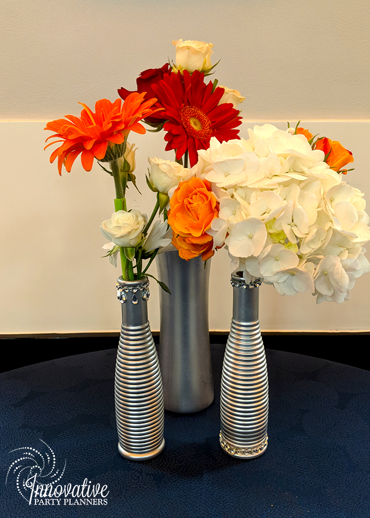 Flower Trio in silver bling bottles_Sagamore_Pendry_Booker 6-10-18.jpg