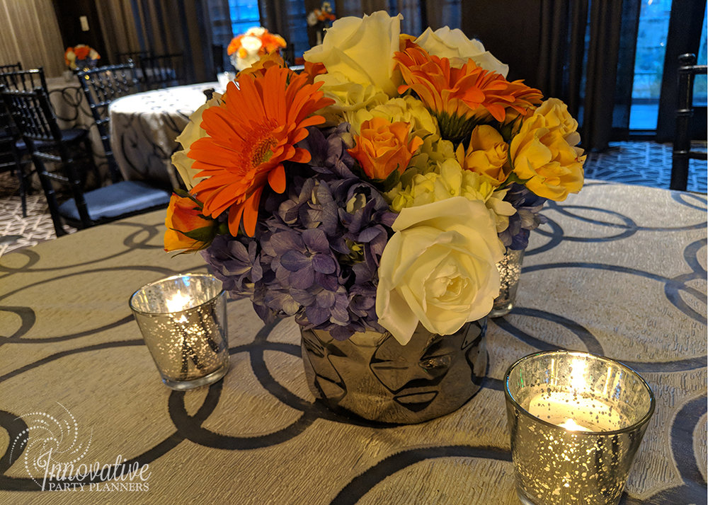 Guest Tables_Price and Parsons_Chrome Vase with Flowers_Orange and Blue_Booker 6-10-18.jpg