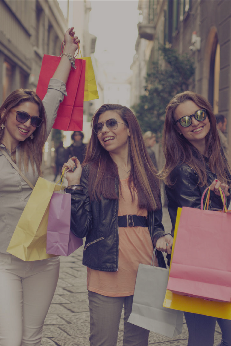 3 happy ladies shopping in open air street sized and filtered.png