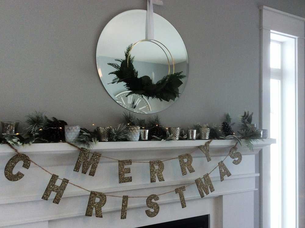 The wreath in the mirror was made by Kathryn Church Designs.