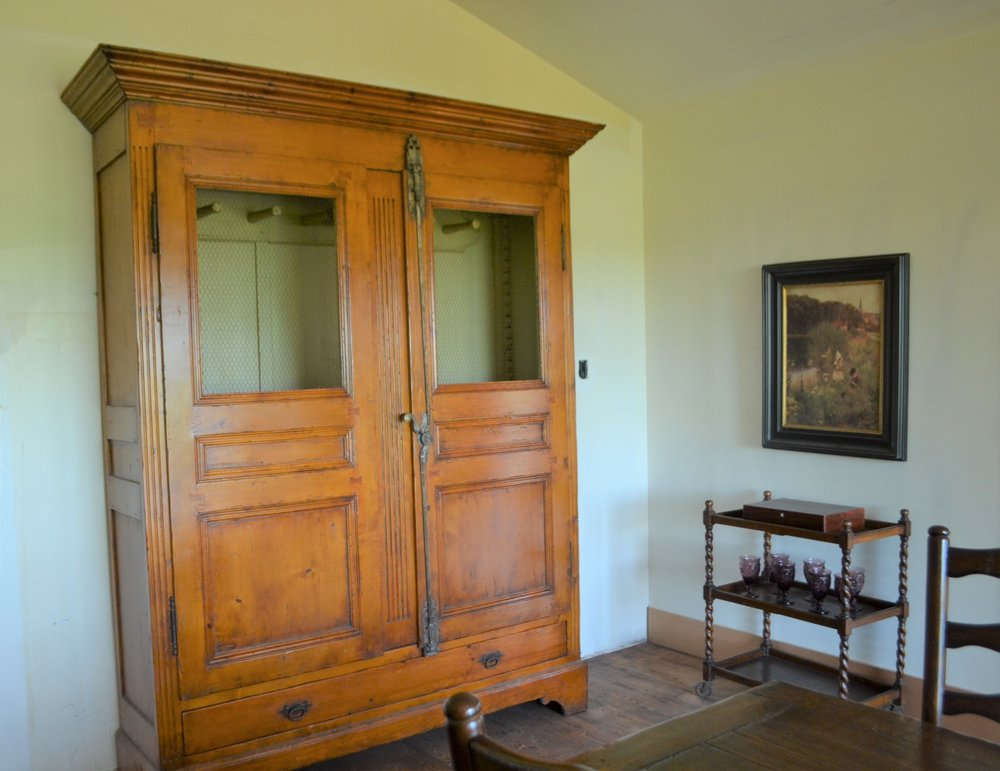 The equine armoire anchors the beautiful dining room