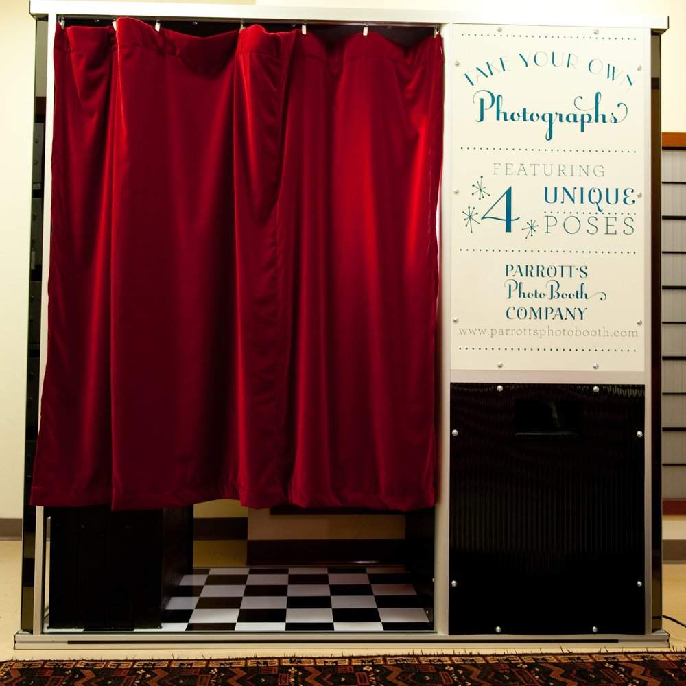 Real Photo Booth - Our custom-built photo booth combines the fun, vintage charm of a photo booth with state-of-the-art technology.  Equipped with a touch screen and sold black background, it is a real booth that you can sit in, close the curtain, and have fun!