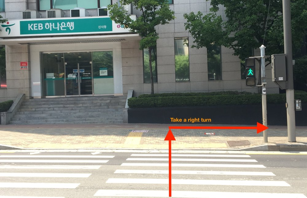 2. Cross towards KEB Bank (하나은행) then take a right turn towards starbucks - When you get off from the bus, cross towards KEB bank just like the picture.