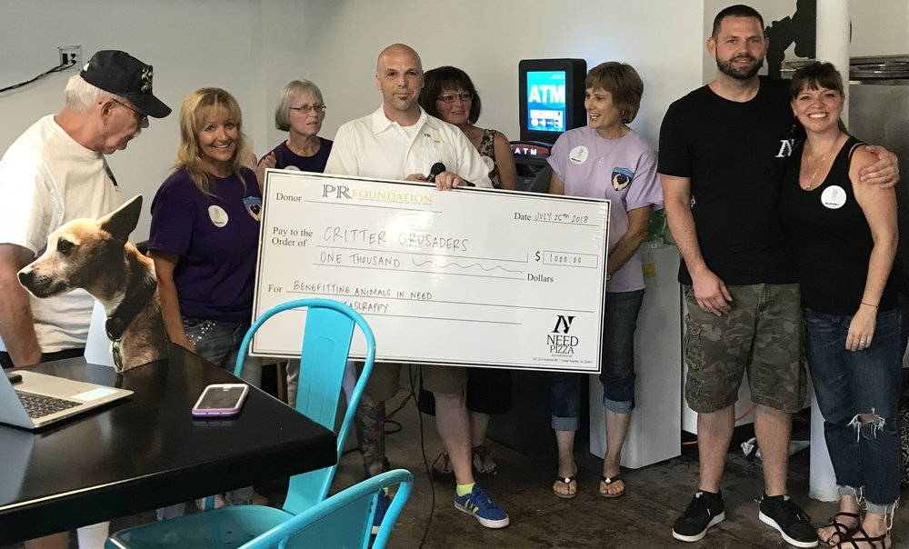 2018 PR Foundation co founder Robert Kabakoff presenting a check to the Critter Crusaders of Cedar Rapids supporting animal welfare in Iowa.
