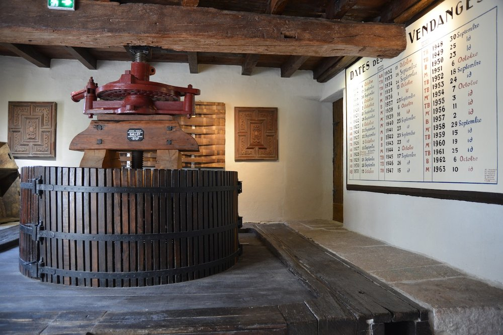 The restored wine press and vintage charts