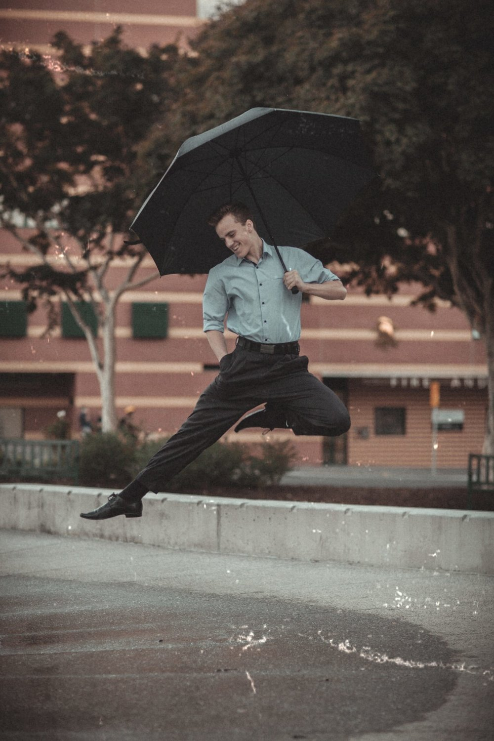 You feel different? This man does, too. Look at him jumping in the air with an umbrella.