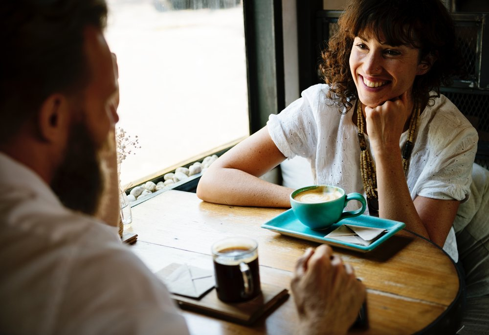 man and woman communicating about mental health