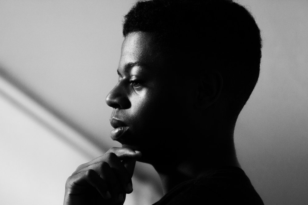African-American man thinking about mental health