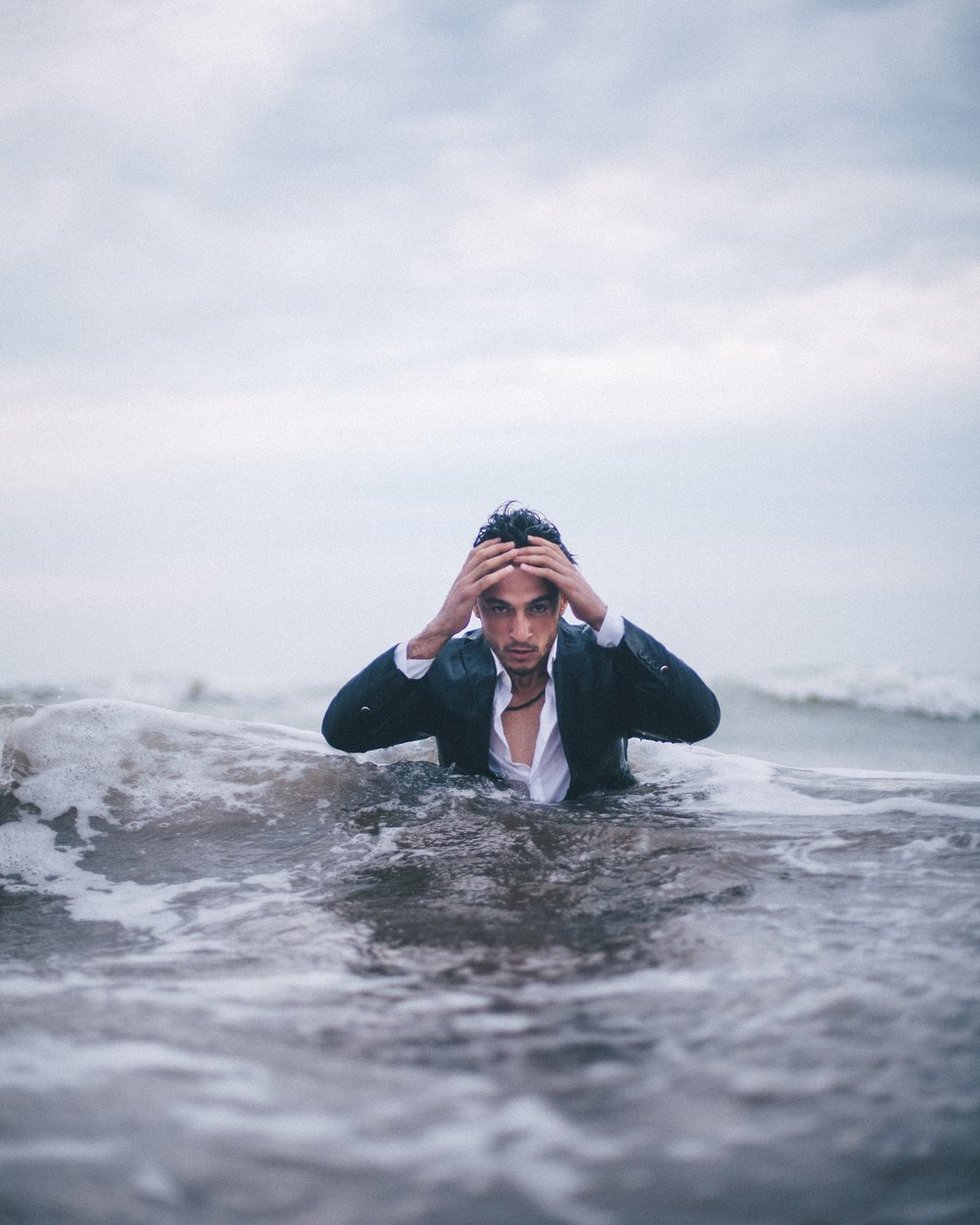 anxious man chest-deep in water