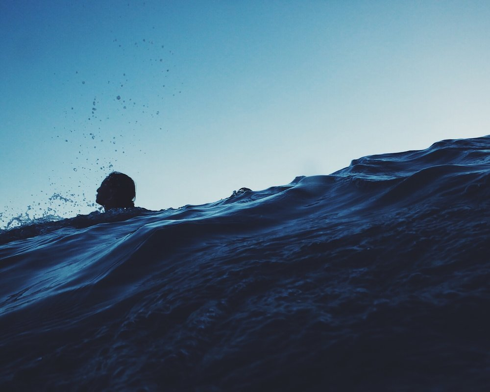 woman with trauma trying to stay afloat
