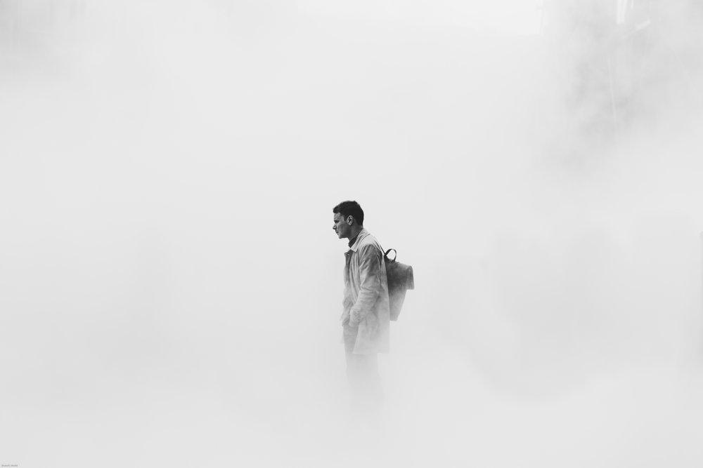 anxious man standing in smoke