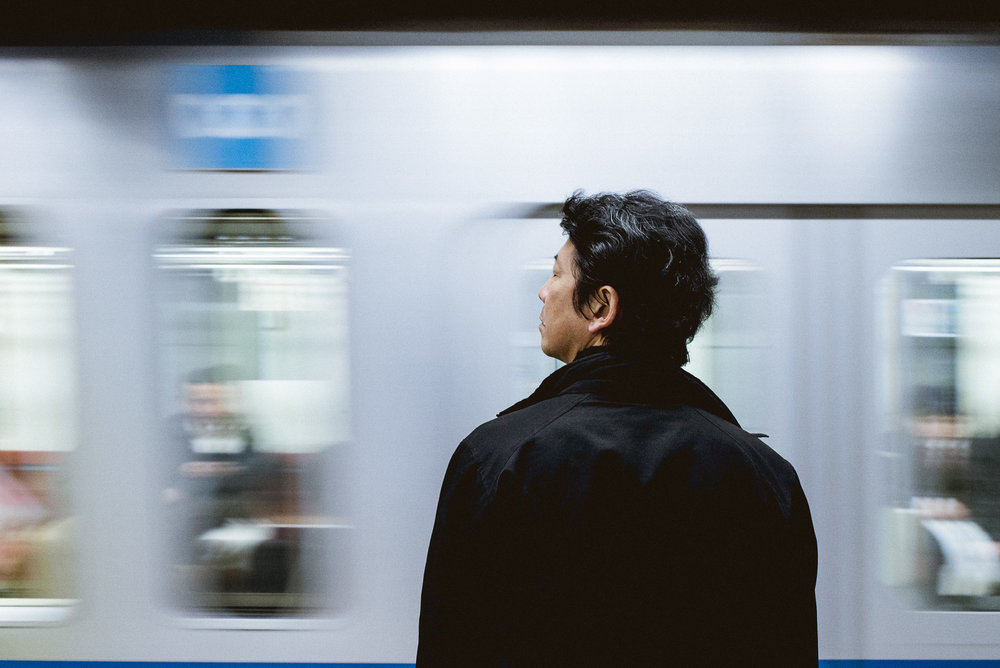 man watching the movement of a train