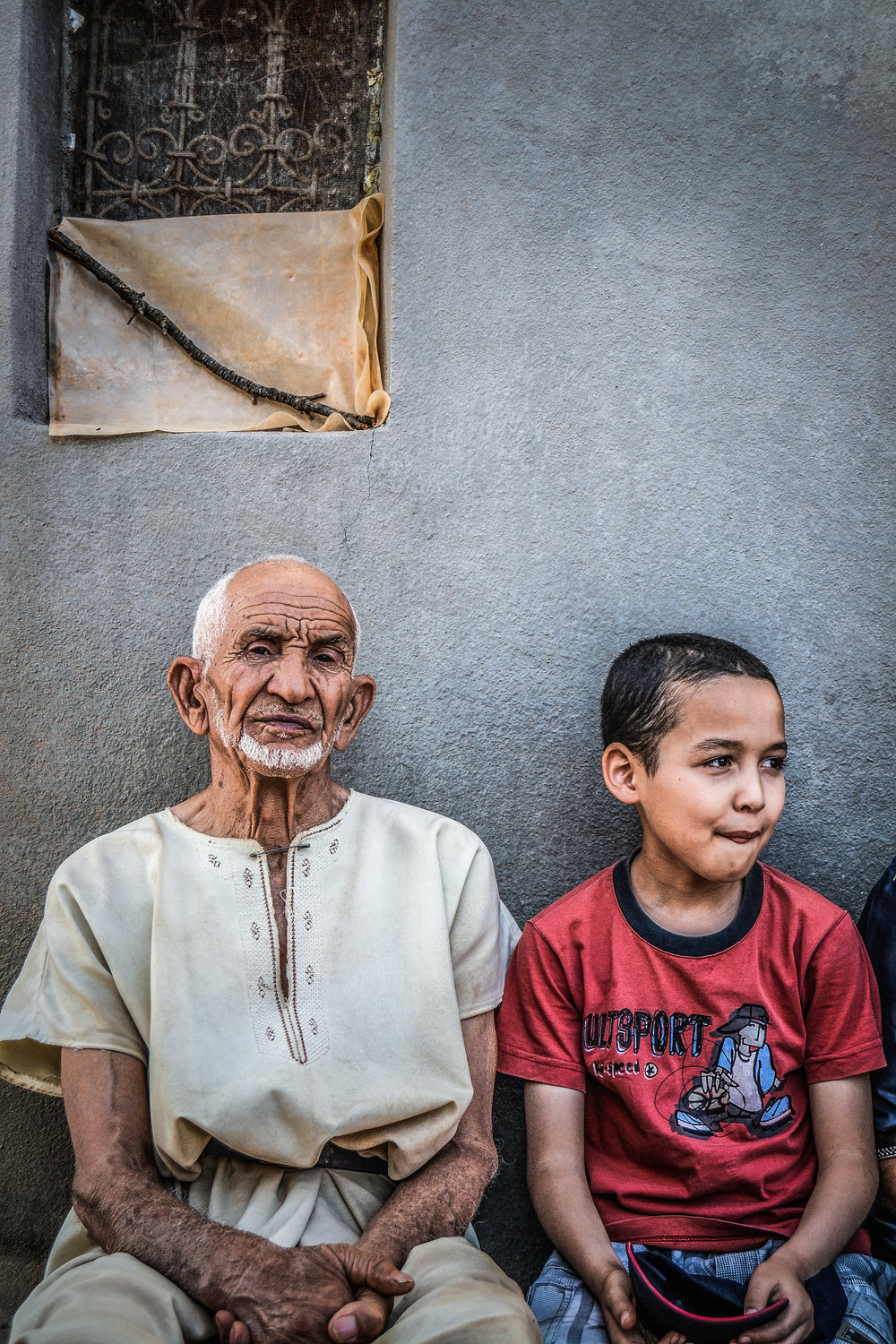 older man and young child sitting next to each other