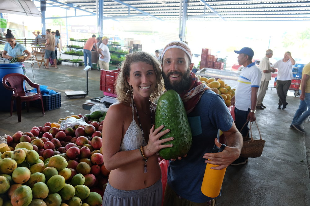 The San Isidro Ferreteria is one of the greatest fruit and veggie markets in all Costa Rica. Here is a picture of Caileigh and our incredible raw chef Jake holding a crown jewel of tropical fruits: The Guanabana!