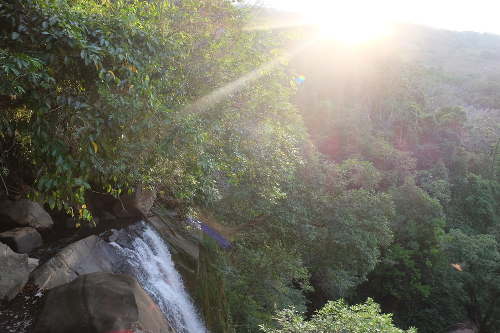 Sit right on the edge of the falls and see the shimmering rainbows below in the cascade of water hitting the rocks!