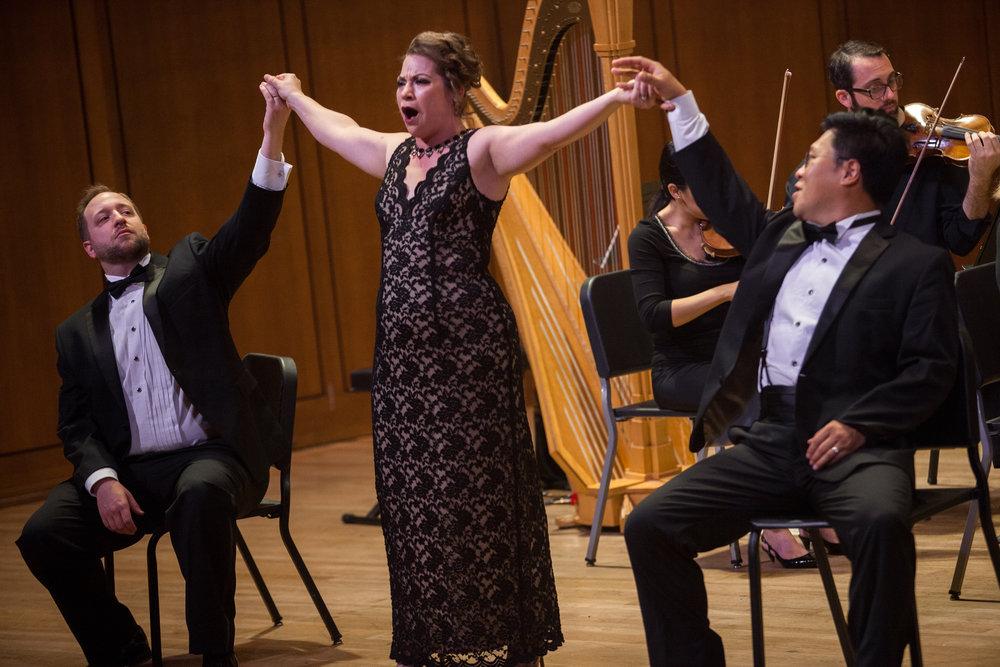 Ellie Jarrett-Shattles, mezzo-soprano, Soonchan Kwon, tenor, and Benjamin Cox, baritone singing a trio.