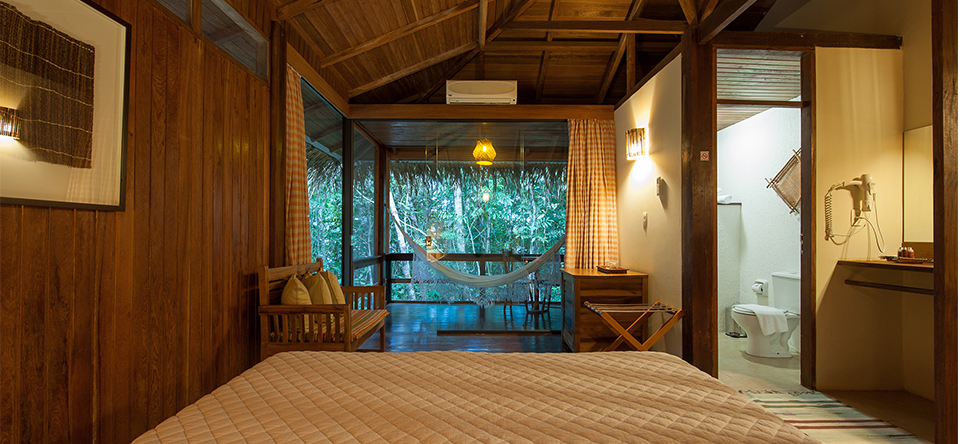 PACKAGE 1 - Cottages with private bath   All rooms are equipped with air-conditioning, minibar, private safe, hair dryer and hot shower. There is also a hammock in the balcony to admire the view. Single, double or triple rooms.  The king size bed is 203cm long and 193cm wide. Single beds are 203cm long and 96cm wide. The extra bed is 188cm long and 88cm wide.