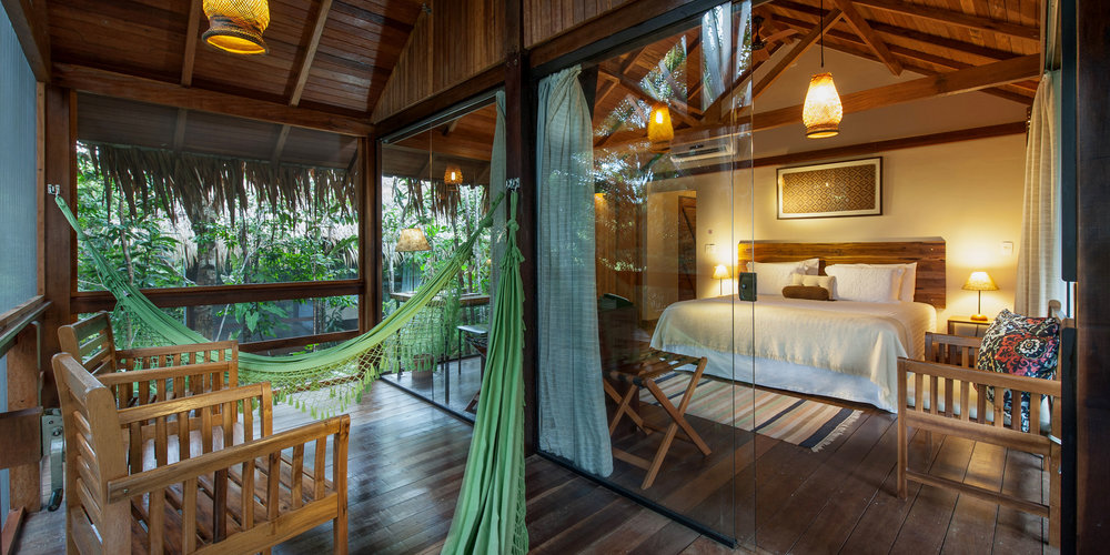 PACKAGE 2 - Bungalow with private bath   All rooms are equipped with air-conditioning, minibar, private safe, hair dryer and hot shower. There is also a hammock in the balcony to admire the view. Single, double or triple rooms.  The king size bed is 203cm long and 193cm wide. Single beds are 203cm long and 96cm wide. The extra bed is 188cm long and 88cm wide.