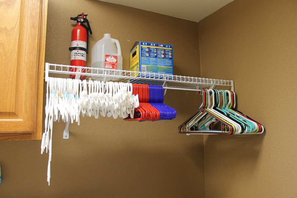 Stacie's family members each have their own type of hanger, so she can easily hang and organize them right out of the dryer.