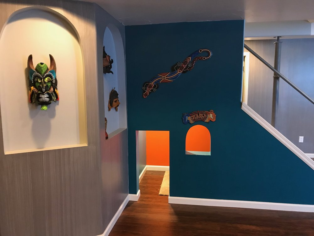 Under the stairs, we made a miniature doorway with a motion sensor light and window for future little kid visitors full of books and dress up clothes. Our son slept there the first night as he wanted to be like Harry Potter and sleep in the little closet under the stairs.