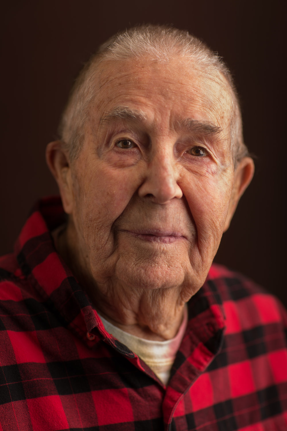 """Ed Hendrickson, 98, of Brewer, Maine, still plans to do some downhill skiing once the snow starts to fly; in 2003 Hendrickson was the recipient of Sugarloaf's Paul Schipper's Iron Man Award. While he's been an avid skier most of his life and the dean of students at Northern Maine Vocational Technical Institute for 17 years, he was also a naval dive-bomber in WWII. Ed flew (and on a couple occasions) had to crash-land planes he was flying. In combat Hendrickson flew SB2C Helldivers. Over the span of just a few days, he shot down one enemy plane only to be hit by enemy fire a couple days later, losing his landing gear on one side, and crash-landing on an aircraft carrier--just the 14th aircraft carrier ever built, according to Hendrickson. """"After they took the gun camera off the plane, they just pushed it overboard,"""" he said. """"That's just how they did things."""" On a previous occasion he wasn't able to land on the carrier and ended up careening off into a lake, where he narrowly escaped being dragged 130 feet to the bottom with his plane. That particular plane, a Douglass SBD Dauntless, was brought back to the surface in the 1990s and now can be seen on display at the National Museum of Naval Aviation in Pensacola, Florida."""
