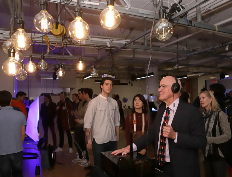 NYU President Andrew D. Hamilton interacting with Reverie Field