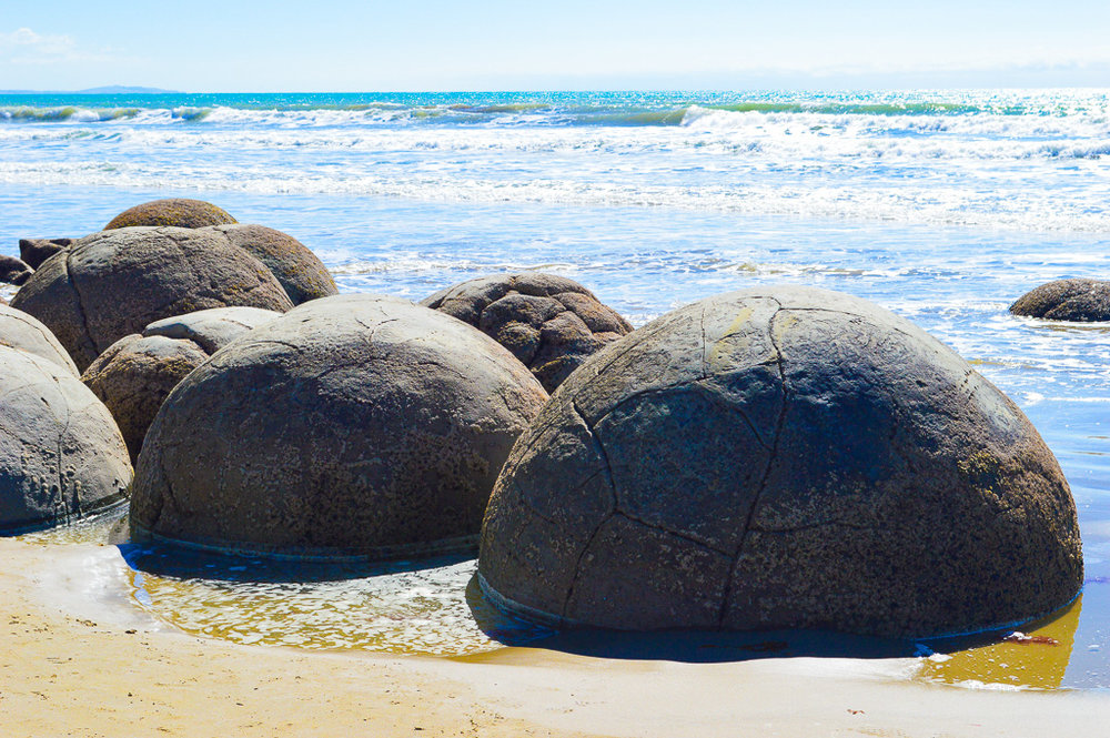 Moeraki Boulders scattered in the sea
