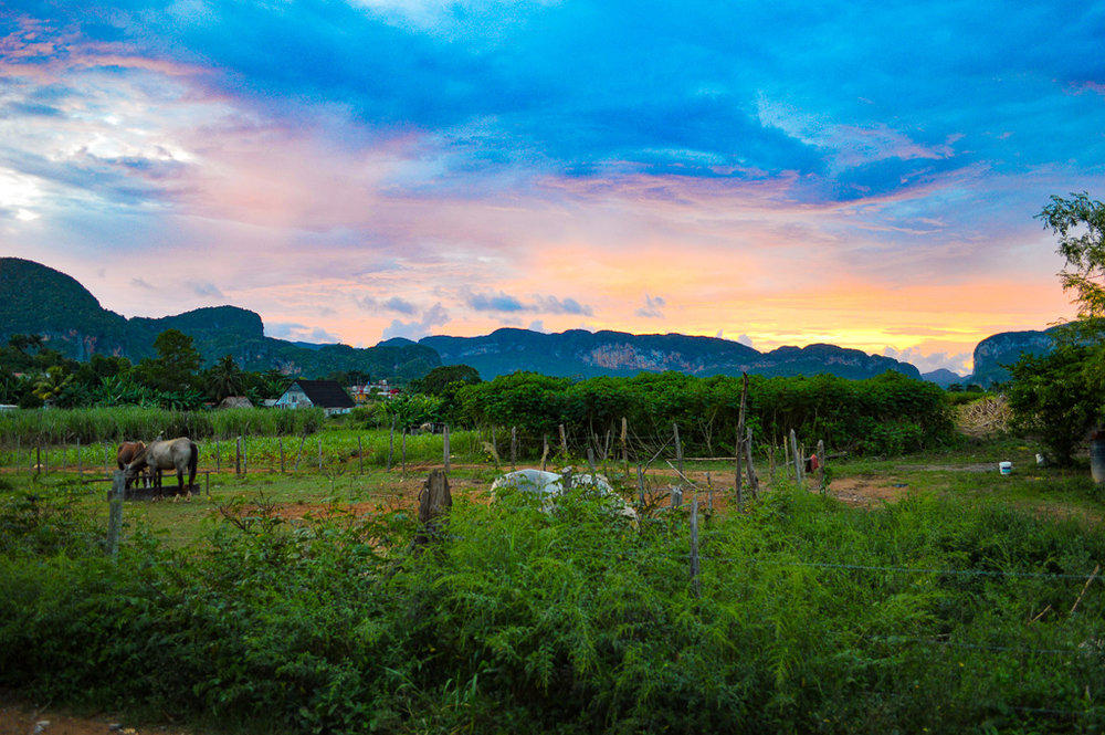 sunset skies over fields in Vinales, Cuba