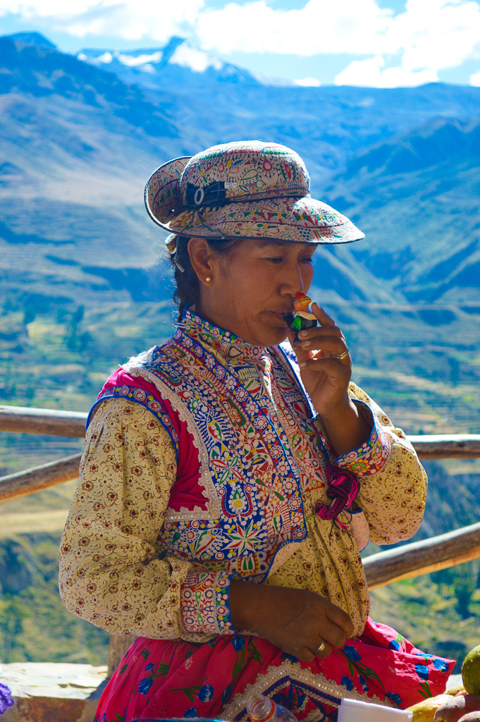 traditional dress Peruvian woman selling souvenirs